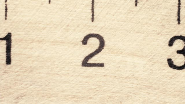 Centimetr wood ruler in macro top view video