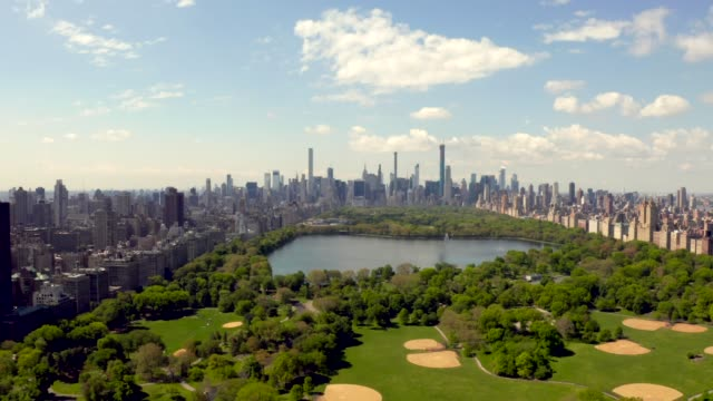 Central Park aerial view, Manhattan Central Park aerial view, Manhattan, New York Park is surrounded by skyscraper central park manhattan stock videos & royalty-free footage