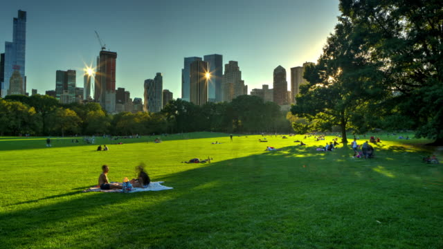 Central park at sunset with crowd of people New York City video
