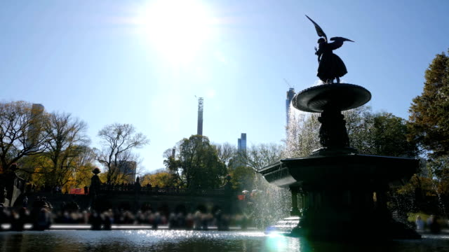Central Park Bethesda Fountain in Central Park in New York Close up of Central Park Bethesda Fountain and square in Central Park in New York. Masked tourists central park manhattan stock videos & royalty-free footage