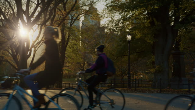 Central Park bicycles at sunset New York City People on bicycles enjoying Central Park at sunset. central park manhattan stock videos & royalty-free footage
