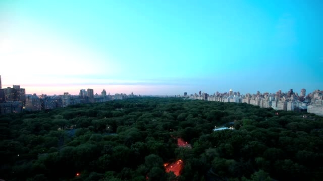 Central Park from day to night - timelapse Timelapse video over Central Park in New York City. From day to night, fast planes and stars. central park manhattan stock videos & royalty-free footage