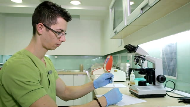 Centrifuge of human stool sample in microbiology lab video