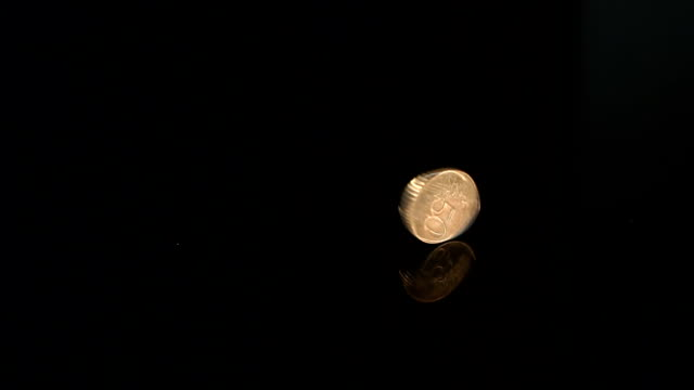 50 cents slowly rotates on a black mirror surface. Coin rotation on the mirror table. 50 cents slowly rotates on a black mirror surface, close-up. us coin stock videos & royalty-free footage