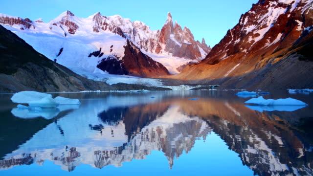 Cerro Torre, Patagonia, Argentina reflected in lake below, at sunrise video