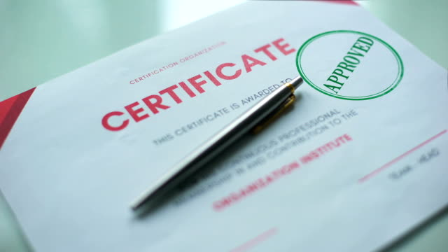 Certificate document approved, hand stamping seal on official paper, validation