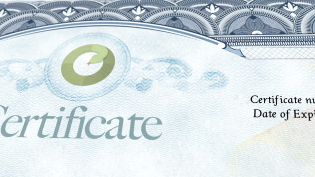Certificate Document Macro pan over certificate document diploma stock videos & royalty-free footage