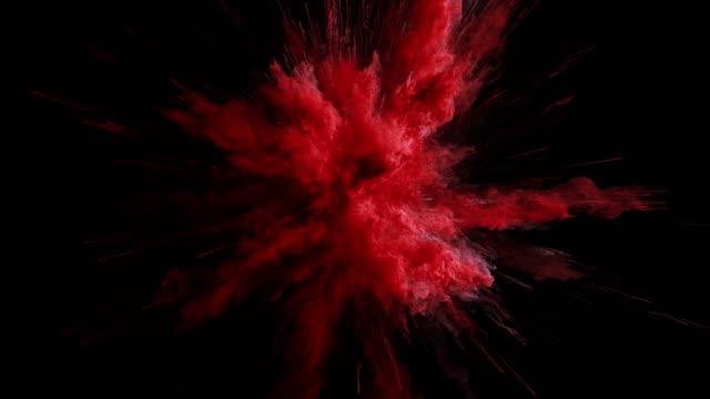 cg animation of red powder explosion on black background. slow motion movement with acceleration in the beginning. has alpha matte - взрывающийся стоковые видео и кадры b-roll