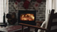istock Chair in front of the fireplace 1195387182