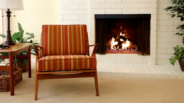 Chair next to fireplace Chair next to fireplace in residential home fireplace stock videos & royalty-free footage