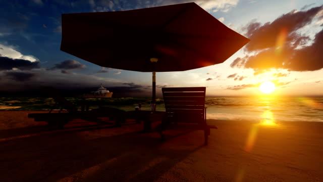 stuhl am strand bei sonnenuntergang - sonnenschirm stock-videos und b-roll-filmmaterial
