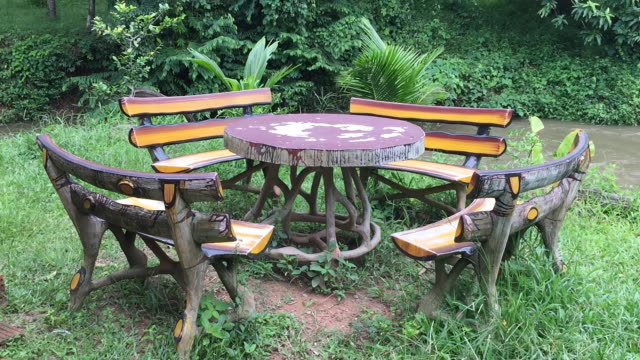 Chairs and table near river