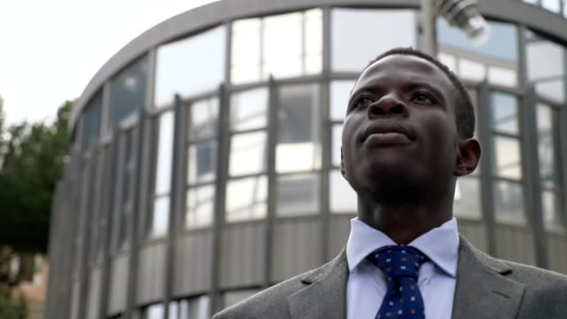 challenge, success, innovation.Young black African business man looks towards th