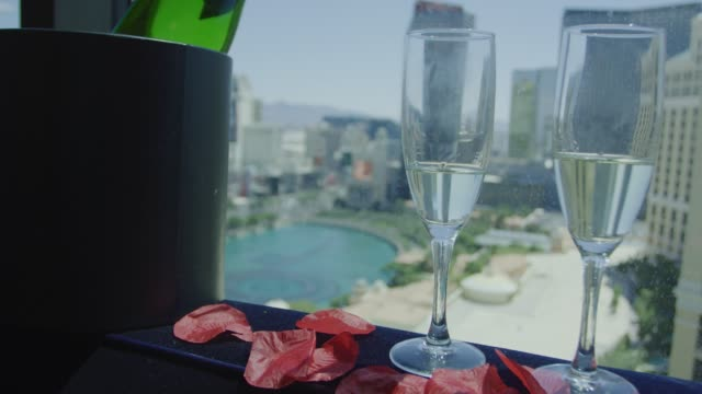 Champagne bottle and glasses in front of Las Vegas view video