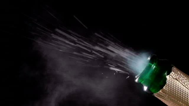 HD - Champagne bottle explosion with cork popping splash. Close-up