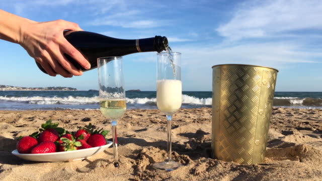 Champagne pour on beach video