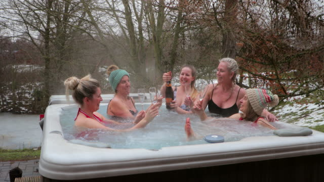 champagne in the hot tub - bachelorette party stock videos and b-roll footage