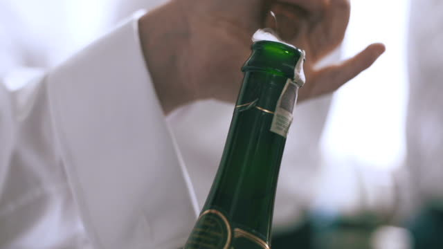 SLO MO of champagne popping and the bubbles spraying video