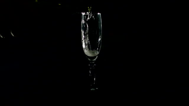 Champagne pouring from bottle into glass. video
