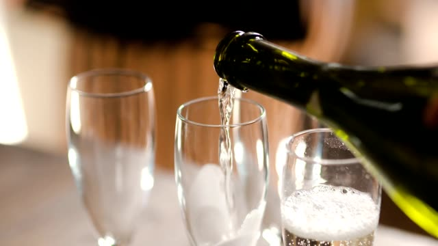 champagne pouring into glass - alchol video stock e b–roll