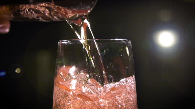 Champagne Pouring (120fps) Freshly-poured Champagne bubbles and fizzes in a flute at 120fps. pink color stock videos & royalty-free footage
