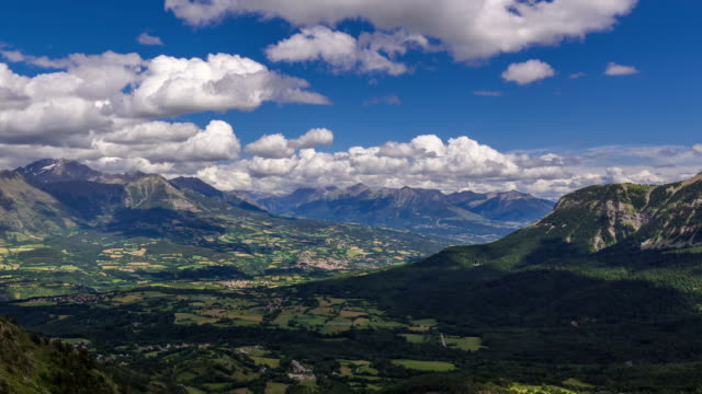 Champsaur Valley in Summer with passing clouds (time-lapse). Hautes-Alpes, Ecrins National Park, Alps, France - vídeo