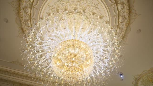 chandelier in a restaurant, interior element chandelier in a restaurant, interior element. victorian architecture stock videos & royalty-free footage
