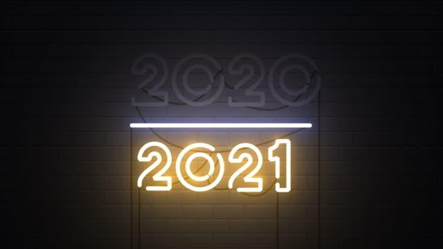 2020-2021 변경 새해 복, 새해 복 2021 네온 사인 배경 - new year 스톡 비디오 및 b-롤 화면