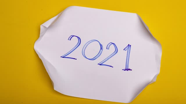 2020-2021 change Happy New Year 2021-Stop motion sign background new year resolution concept.