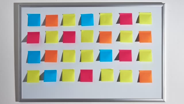 changing pattern of colorful sticky notes. - post it video stock e b–roll