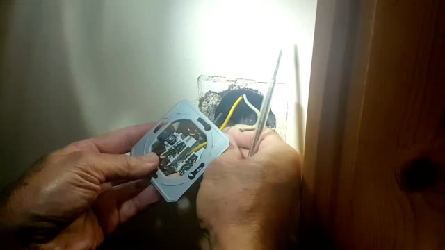 changing the electrical outlet at a house with tools. - pinze attrezzo manuale video stock e b–roll
