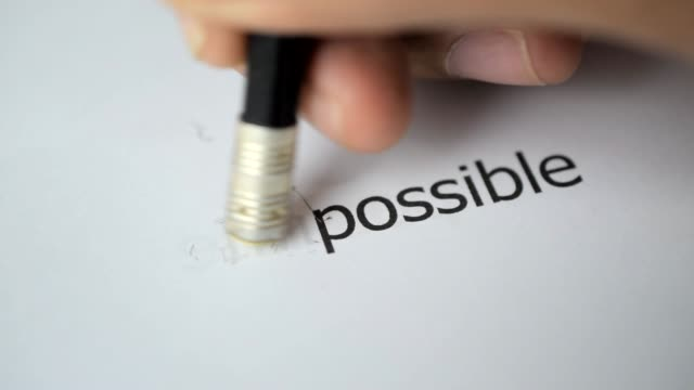 changing the word impossible to possible with a pencil eraser - opportunity stock videos & royalty-free footage