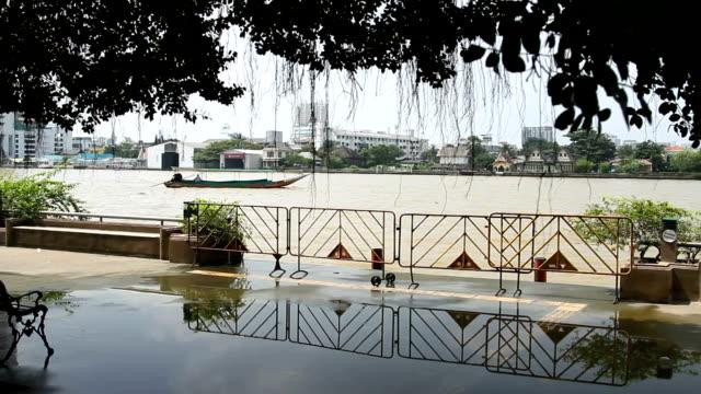 Chao Phraya river embankment. Boat shakes on waves. Bangkok, Thailand video