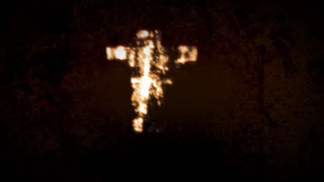Chaotic Grunge Cross spotlit on textured background with Matte video