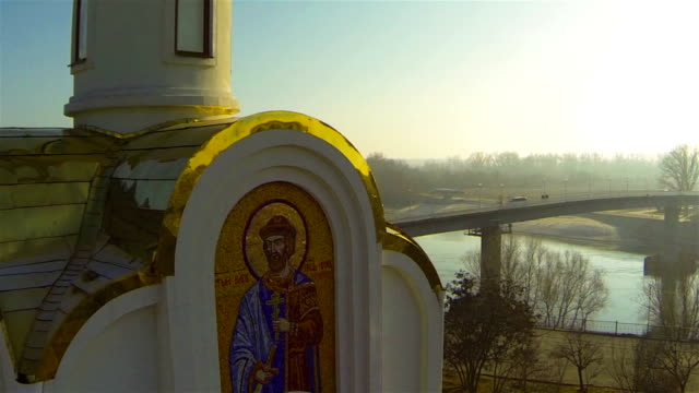 Chapel near river with the bridge video