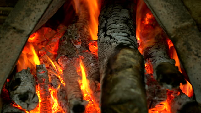 vídeos de stock e filmes b-roll de charcoal burning in bbq in the fireplace frame background. - burned oven