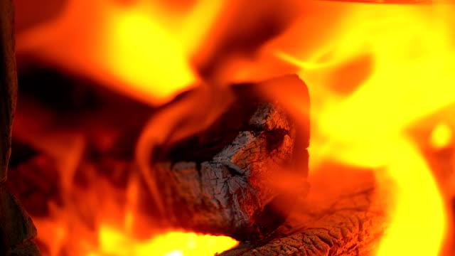 vídeos de stock e filmes b-roll de charcoal burning in the fireplace frame background. - burned oven