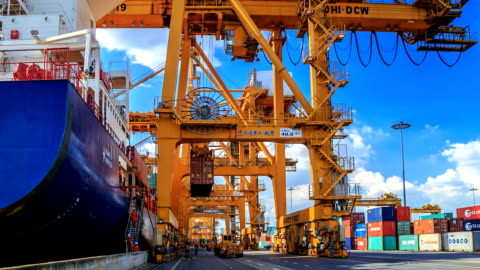 charge Loading Containers From Ship Into Warehouse Of Industrial Cargo harbor stock videos & royalty-free footage