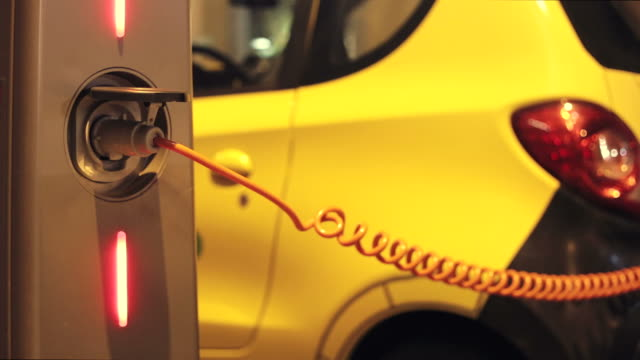 Charging an electric car in the city. video