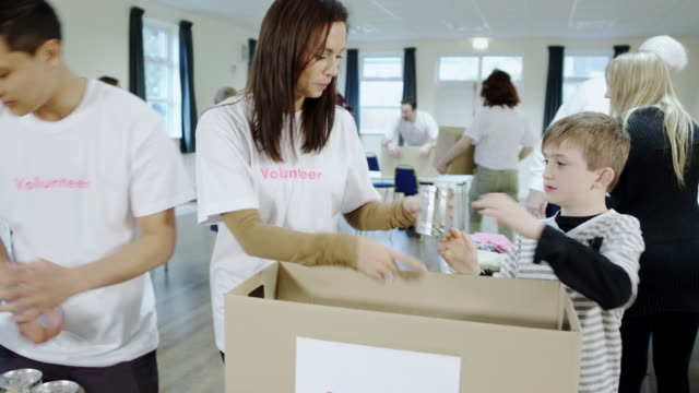 Charity volunteers and community giving video