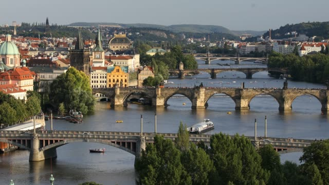 charles bridge, prague, czech republic. charles bridge (karluv most) and old town tower at sunset. - barocco video stock e b–roll