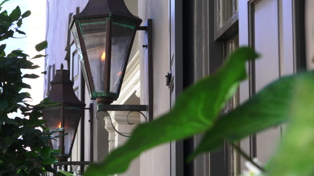 Charleston, Gass Lanterns Footage shot with Sony FDR-AX100 using natural lighting.  This shot was taken of iconic gas lanterns that appear throughout the historic districts of many historical towns.  This happens to be in Charleston, but could easily be Savannah, or New Orleans.  These lanterns provide a wonderful look/feel to the streets in either day or evening. south carolina stock videos & royalty-free footage