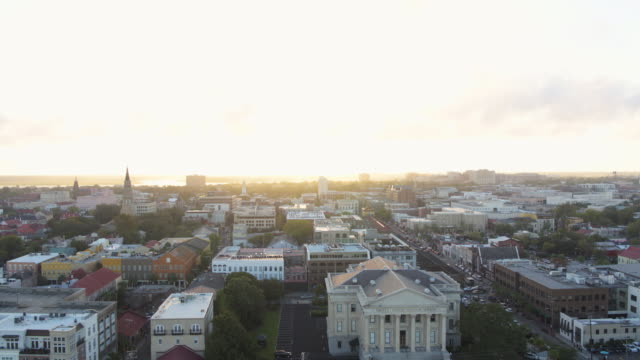 Charleston South Carolina Aerial v127 Flying low to high around French Quarter with city view at sunset