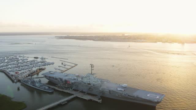 Charleston South Carolina Aerial v131 Birdseye view panning around aircraft carrier ship at sunset