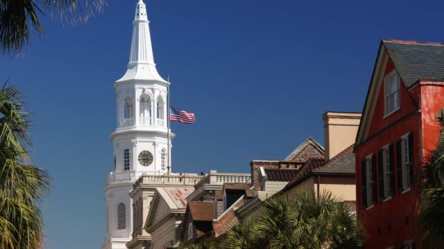 Charleston South Carolina downtown business district Row of old historic downtown business buildings and Saint Michael's Church on Broad and Meeting streets in Charleston South Carolina USA south carolina stock videos & royalty-free footage