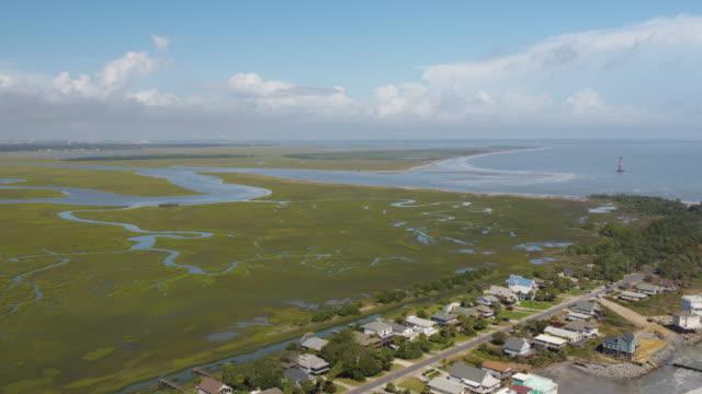 Charleston South Carolina Folly Beach Aerial v49 Flying high to low over Folly Beach & wetland October 2017 marsh stock videos & royalty-free footage