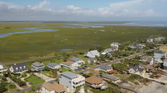 Charleston South Carolina Folly Beach Aerial v50 Panning low to high over Folly Beach neighborhood October 2017 marsh stock videos & royalty-free footage