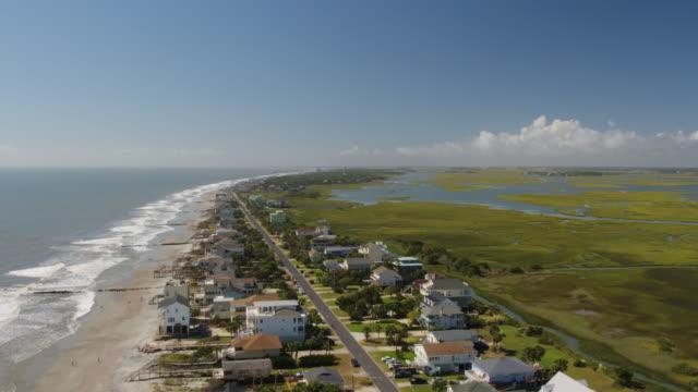 Charleston South Carolina Folly Beach Aerial v51 Flying high to low over Folly Beach neighborhood & water October 2017 marsh stock videos & royalty-free footage