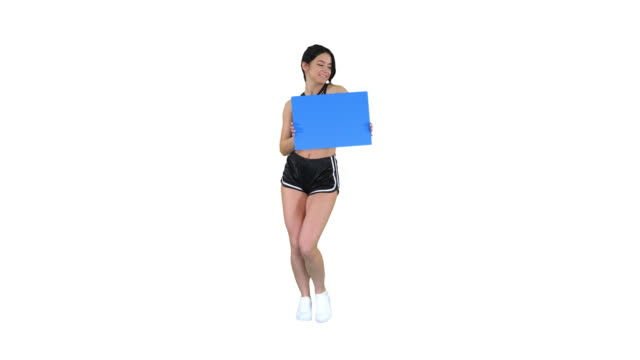 vídeos de stock e filmes b-roll de charming girl holding empty board and dancing on white background - alfabeto