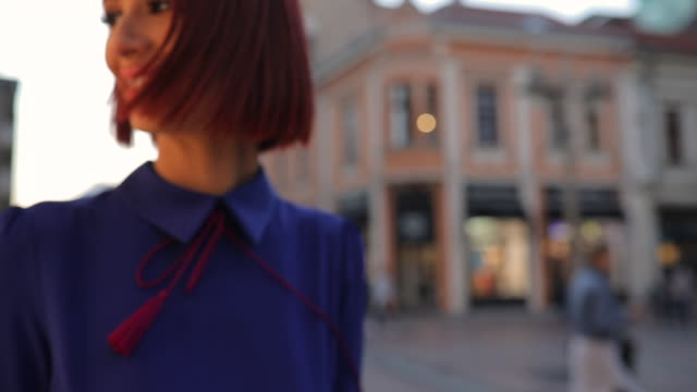 Charming lady in blue dress One woman, beautiful elegant young redhead lady, walking the city street. dyed red hair stock videos & royalty-free footage
